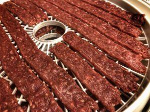 sweet-beef-jerky-recipe-strips-in-the-dehydrator