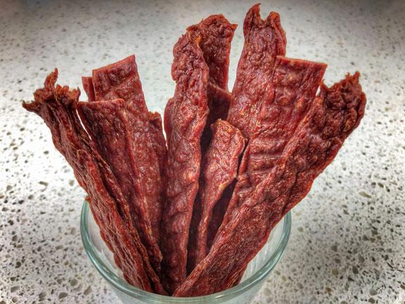 sweet-beef-jerky-recipe-strips-standing-in-glass